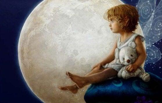 Jongen met beer op de maan