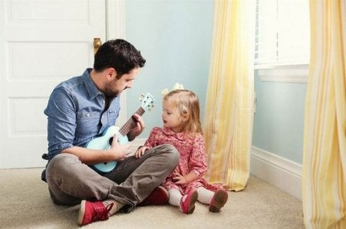 Vader leert dochter ukelele spelen