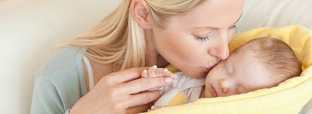 Moeder en verkouden baby