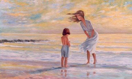 Moeder en kind op het strand