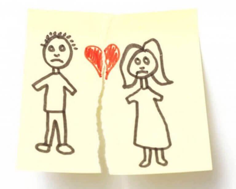 Tekening van een man en een vrouw met een gebroken hart